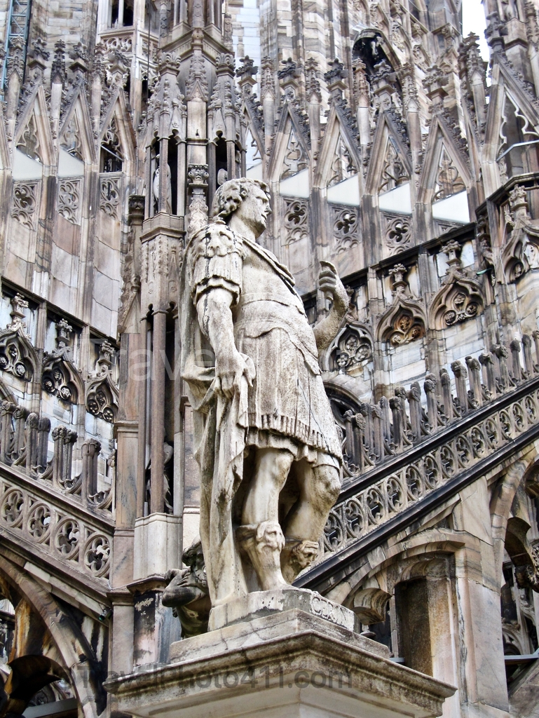 A statue on top of Duomo in Milan